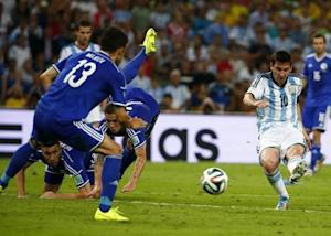 Argentina's Lionel Messi scores a goal during the 2014 World Cup Group F soccer match against Bosnia and Herzegovina at the Maracana stadium in Rio de Janeiro