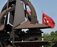 "<p>A Turkish flags flutters outside the NATO headquarters in Brussels. NATO condemned Syria's downing of a Turkish jet as ""unnacceptable"" and expressed ""strong support and solidarity"" with Turkey after emergency consultations in Brussels.</p>"