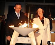 Opposition Leader Tony Abbott watches as Australian PM Julia Gillard lights a beacon to mark Queen Elizabeth II's diamond jubilee in June. Gillard and Abbott were among those voting against legalising same-sex unions