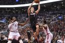 Toronto Raptors' DeMarre Carroll (5) defends as Miami Heat's Goran Dragic (7) drives for the basket during the second half in Game 1 of a second-round NBA basketball playoff series, Tuesday, May 3, 2016 in Toronto. (Frank Gunn/The Canadian Press via AP) MANDATORY CREDIT