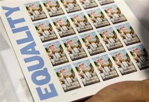 "A page of U.S. Postal Service limited-edition stamps commemorating the 1963 'March on Washington for Jobs and Freedom"" is displayed in Washington"
