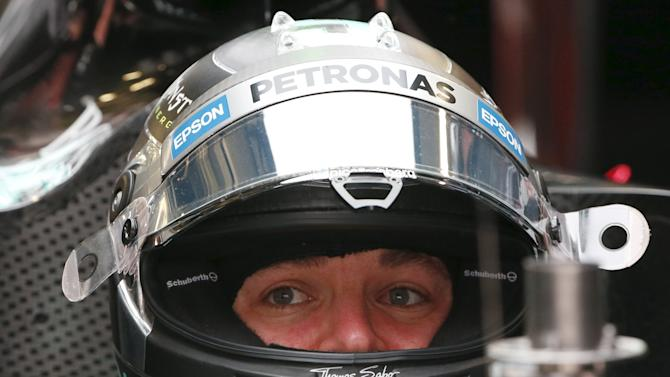 Mercedes Formula One driver Rosberg of Germany sits in his car during the first practice session of the Russian F1 Grand Prix in Sochi