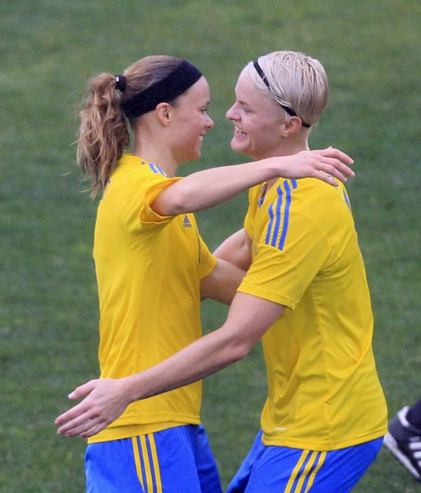 Sweden's Thunebro celebrates her goal against China with teammate Fischer during their women's Algarve Cup soccer match at the Parchal stadium in Parchal