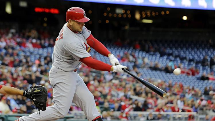 St. Louis Cardinals' Matt Holliday (7) hits a fly ball for an out during the first inning of a baseball game against the Washington Nationals at Nationals Park, Monday, April 22, 2013, in Washington. (AP Photo/Alex Brandon)