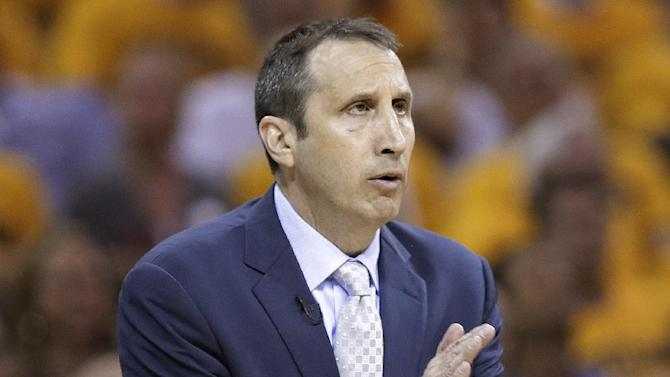 Cleveland Cavaliers coach David Blatt encourages players during the first half of Game 4 of the NBA basketball Eastern Conference finals against the Atlanta Hawks, Tuesday, May 26, 2015, in Cleveland. The Cavaliers won 118-88. (AP Photo/Tony Dejak)