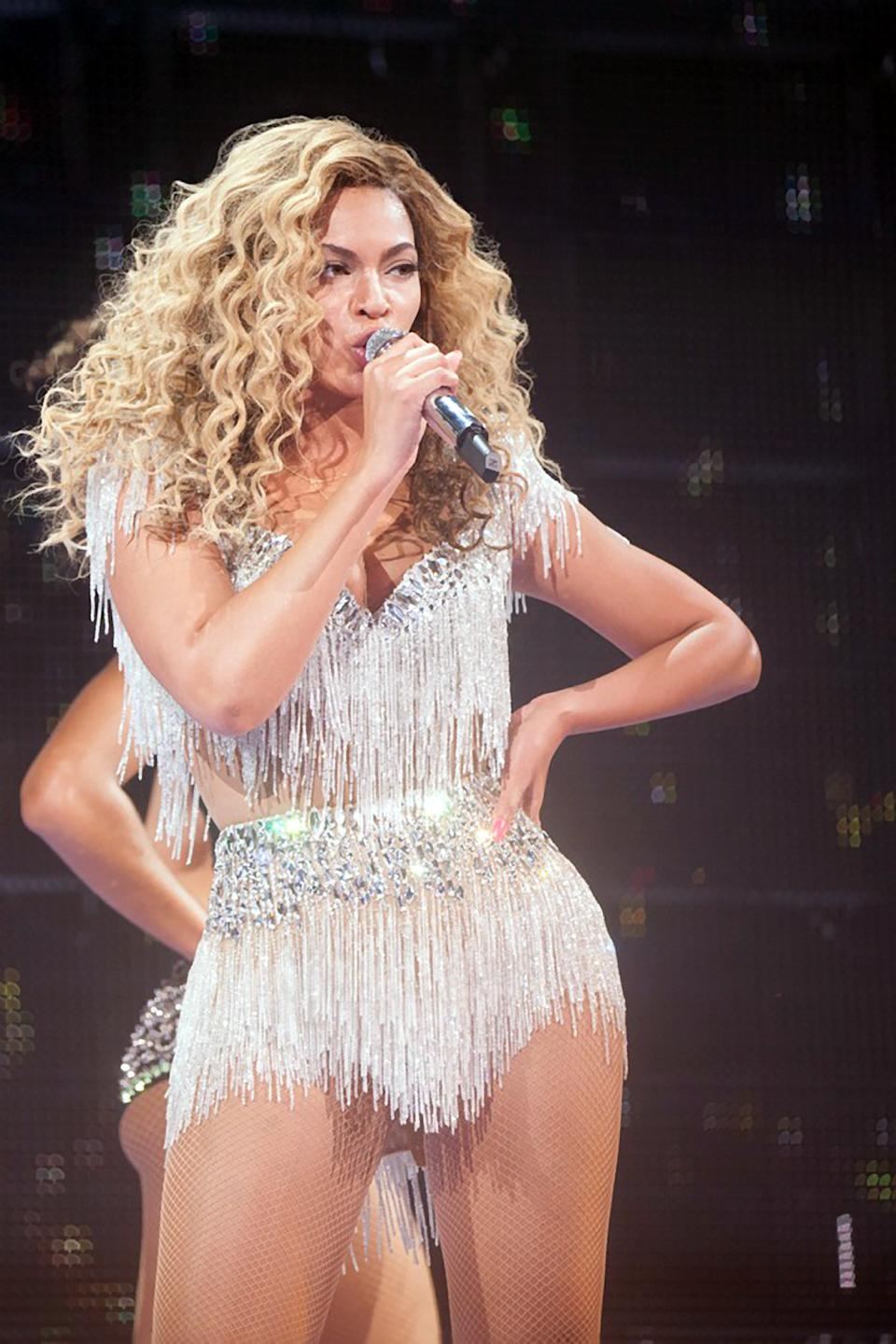 In this Friday May 25, 2012 photo provided by Parkwood Entertainment, Beyonce performs at Revel in Atlantic City, N.J., for the resort's premiere.  It is the first of four scheduled shows for Memorial Day weekend.  (AP Photo/Parkwood Entertainment, Robin Harper)