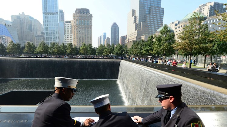 Volunteer firefighters stop to remember victims at 9/11 Memorial in New York