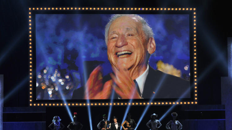Honoree Mel Brooks reacts on a video screen as Martin Short and dancers perform a musical tribute to him during the American Film Institute's 41st Lifetime Achievement Award Gala at the Dolby Theatre on Thursday, June 6, 2013 in Los Angeles. (Photo by Chris Pizello/Invision/AP)