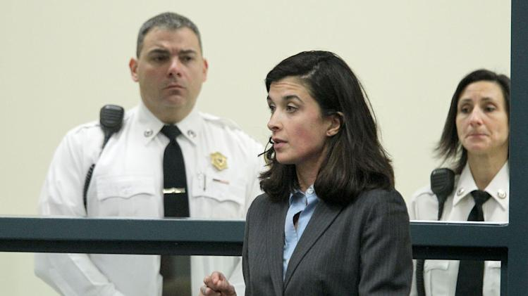 POOL -  Defense attorney Melinda Thompson addresses the judge at the arraignment of Aisling McCarthy Brady in Cambridge District Court, in Medford, Mass., on Tuesday, January 22, 2013.  Brady is charged with assault and battery on a 1-year-old girl, who subsequently died.   (AP Photo/The Boston Globe, Pat Greenhouse, Pool)   Topic: nanny Reporter: Peter Schwarm