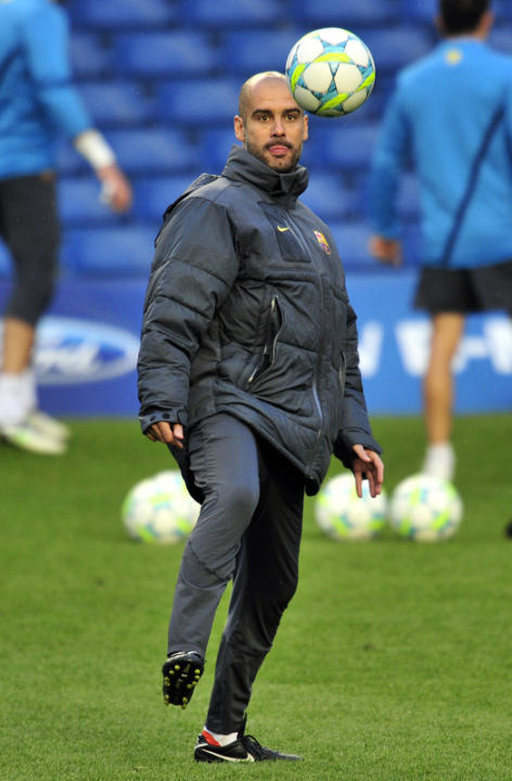 Pep Guardiola, Then Barcelona's Coach, Taking Part In A Training Session At Stamford Bridge In London, On The Eve Of AFP/Getty Images