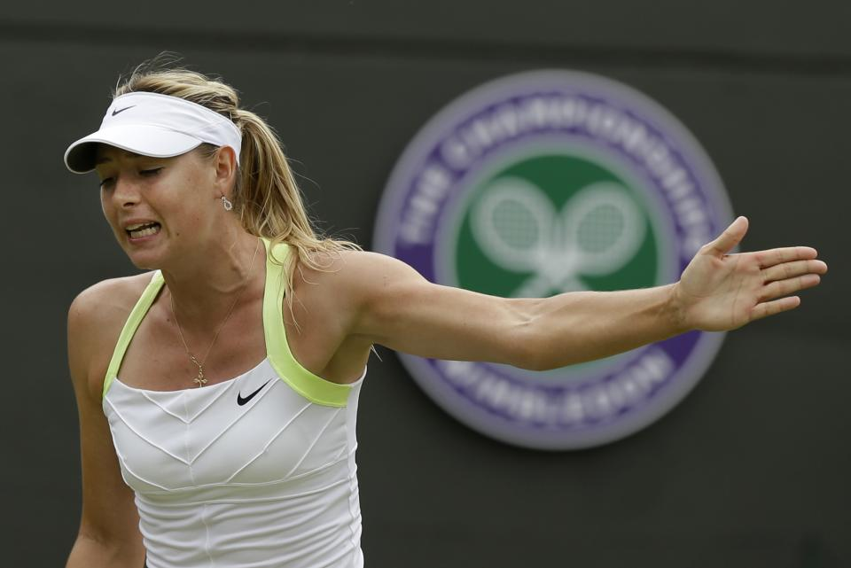 Maria Sharapova of Russia reacts during a second round women's singles match against Tsvetana Pironkova of Bulgaria at the All England Lawn Tennis Championships at Wimbledon, England, Thursday, June 28, 2012. (AP Photo/Sang Tan)