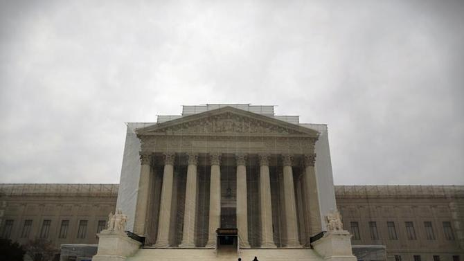 People walk in front of the Supreme Court building in Washington