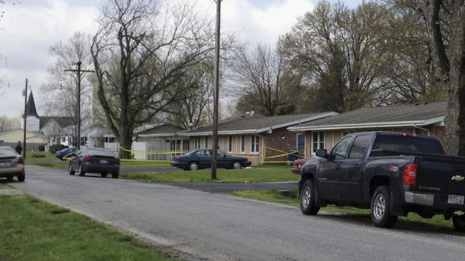 Police tape is seen around a house in Manchester, Ill., Wednesday, April 24, 2013, where the bodies of five people were found slain early Wednesday in the tiny southwestern Illinois town. Authorities said a suspect was injured and taken into custody. (AP Photo/Regina Garcia Cano)