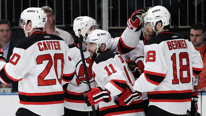 New Jersey Devils' Stephen Gionta, center, celebrates with Ryan Carter, left, and Steve Bernier, right, after scoring against the New York Rangers during the first period of Game 5 of an NHL hockey Stanley Cup Eastern Conference final playoff series Wednesday, May 23, 2012, in New York.  (AP Photo/Frank Franklin II)
