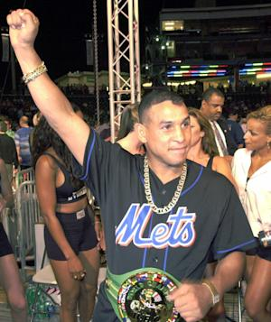 """FILE -  In this July 7, 2001 file photo, boxing champ Hector """"Macho"""" Camacho acknowledges fans at KeySpan Park in New York's Coney Island. Camacho, a boxer known for skill and flamboyance in the ring, as well as for a messy personal life and run-ins with the police, has died, Saturday, Nov. 24, 2012, after being taken off life support. He was 50. (AP Photo/Stephen Chernin, File)"""
