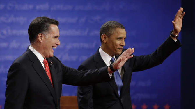 Republican presidential nominee Mitt Romney, left and President Barack Obama wave to the audience during the first presidential debate at the University of Denver, Wednesday, Oct. 3, 2012, in Denver. (AP Photo/David Goldman)
