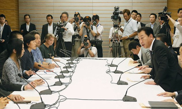 Japan&#39;s Prime Minister Yoshihiko Noda, right, talks with the leaders of the anti-nuclear protest at the prime minister&#39;s official residence in Tokyo, Japan, Wednesday, Aug. 22, 2012. Prime Minister Noda has invited leaders of weekly anti-nuclear protests outside his office for a rare meeting, allowing them inside the complex for the first time. (AP Photo/Kyodo News) JAPAN OUT, MANDATORY CREDIT, NO LICENSING IN CHINA, HONG KONG, JAPAN, SOUTH KOREA AND FRANCE