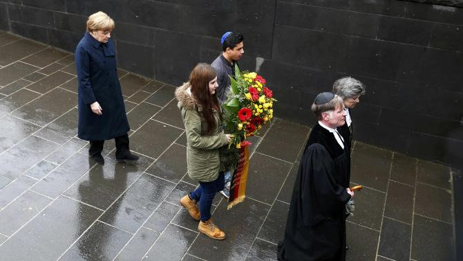 German Chancellor Merkel attends a wreath laying ceremony at the Israeli memorial in the former German Nazi concentration camp in Dachau