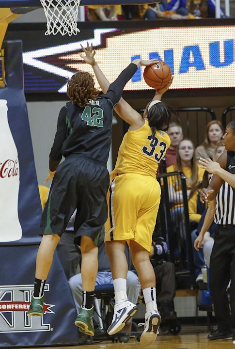 Baylor's Brittney Griner (42) blocks the shot of West Virginia's Ayana Dunning (33) during the first half of an NCAA college basketball game in Morgantown, W.Va., on Saturday, March 2, 2013. (AP Photo