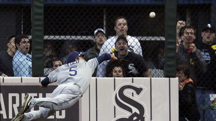 ** CORRECTS DATE ** Tampa Bay Rays right fielder Sam Fuld makes a diving catch on a fly ball hit by Chicago White Sox's Juan Pierre during the fourth inning of a baseball game in Chicago, Saturday, April 9, 2011. (AP Photo/Nam Y. Huh)