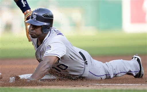 Rockies top Tigers 12-4 with 8 runs in 10th inning