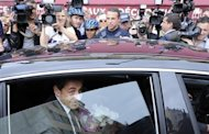 Former French president Nicolas Sarkozy leaves by car after a lunch with UMP political party members in Nice September 27, 2013. REUTERS/Olivier Anrigo