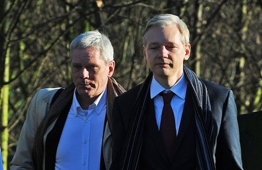 <p>WikiLeaks founder Julian Assange (right) arrives at a London court in 2011 with WikiLeaks spokesman Kristinn Hrafnsson. Hrafnsson on Thursday warned Britain against any attempt to enter Ecuador's London embassy and arrest his colleague Assange, who has been granted asylum.</p>