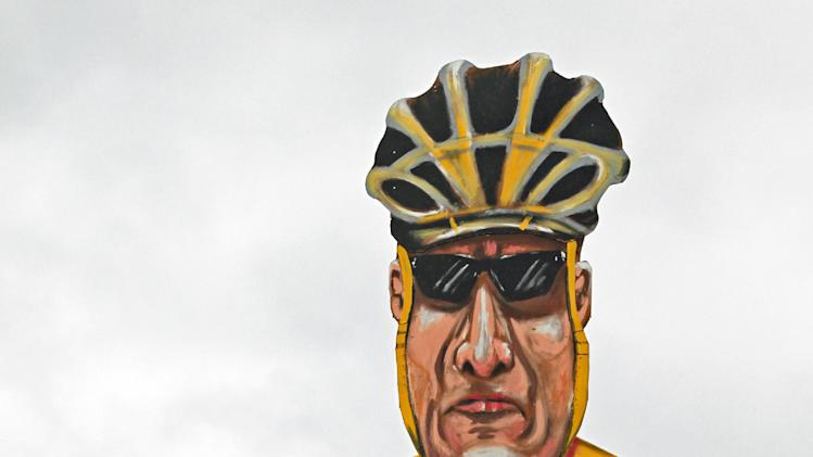 Artist Frank Shepherd poses with his creation of U.S. cyclist Lance Armstrong who has been unveiled as this year's Edenbridge Bonfire Society celebrity guy, during an unveiling for the media in Edenbridge, England, Wednesday Oct. 31, 2012.  The Edenbridge Bonfire Society has a long tradition of building symbolic effigies of famous people to burn during their Guy Fawkes bonfire night, and this year it will be disgraced Tour de France cyclist Lance Armstrong who gets torched for his villainy in sport.  (AP Photo / Gareth Fuller, PA) UNITED KINGDOM OUT - NO SALES - NO ARCHIVES
