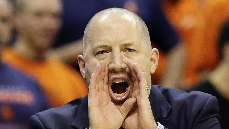 Marquette head coach Buzz Williams yells instruction to the court during the first half of the East Regional final in the NCAA men's college basketball tournament against Syracuse, Saturday, March 30, 2013, in Washington. (AP Photo/Alex Brandon)