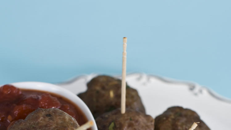 In this image taken on Monday, Nov. 26, 2012, cocktail meatballs with cranberry marinara are shown served on a platter in Concord, N.H. (AP Photo/Matthew Mead)