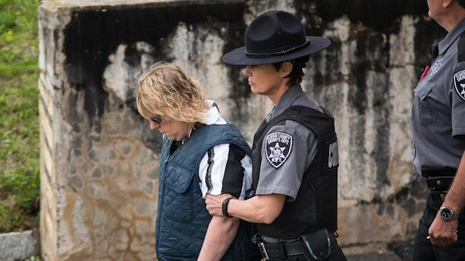 Joyce Mitchell (L) is lead from Plattsburgh Ciy Court after a hearing on June 15, 2015 in Plattsburgh, New York