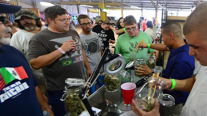Marijuana is weighed at Los Angeles, California's first-ever cannabis farmer's market at the West Coast Collective medical marijuana dispensary on July 4, 2014