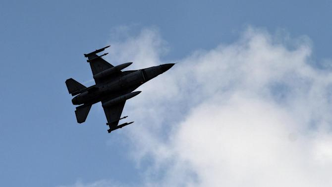 FILE - In this file photo taken Saturday, Aug. 31, 2013, a Turkish fighter jet flies above the Incirlik airbase, southern Turkey. Turkish fighter jets shot down a Syrian warplane after it violated Turkey's airspace Sunday, March 23, 2014, Turkish Prime Minister Recep Tayyip Erdogan said, in a move likely to ramp up tensions between the two countries already deeply at odds over Syria's civil war. (AP Photo/Vadim Ghirda, File)