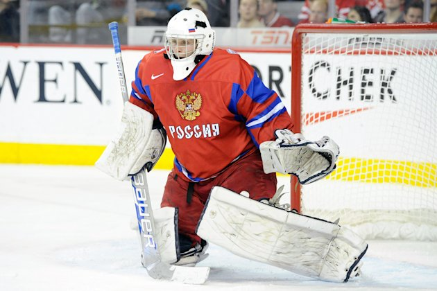 Andrei Makarov #20 of Team Russia watches play during the 2012 World Junior Hockey Championship Gold Medal game against Team Sweden at the Scotiabank Saddledome on January 5, 2012 in Calgary, Alberta, Canada. Team Sweden defeated Team Russia 1-0 in overtime. (Photo by Richard Wolowicz/Getty Images)