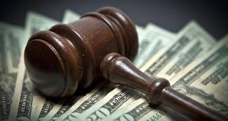 Gavel on money copyright Derek Hatfield/Shutterstock.com