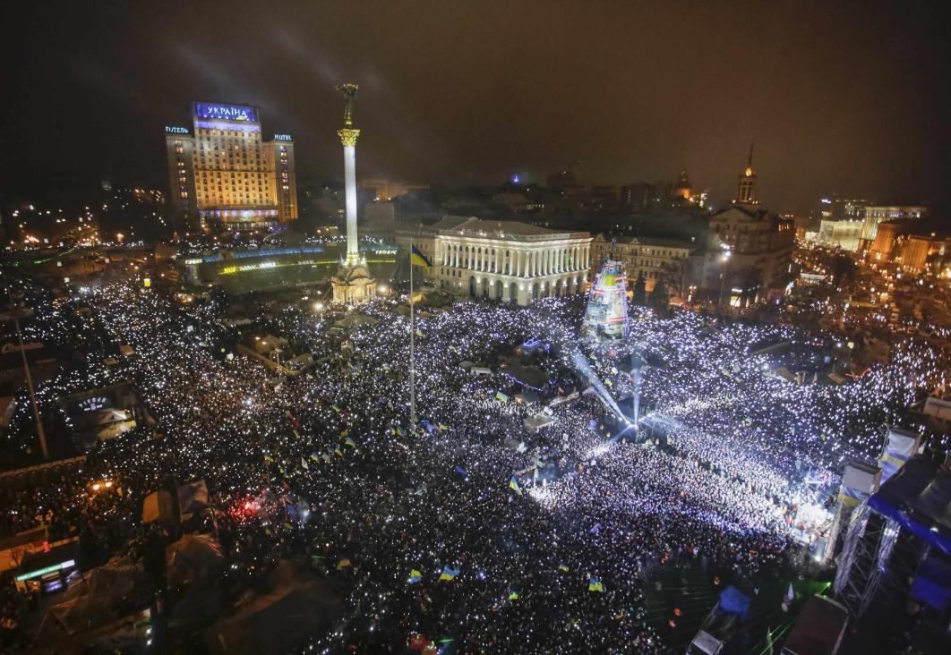 Pro-European integration supporters take part in New Year celebrations in Independence Square in central Kiev