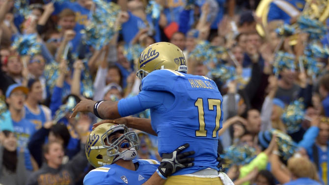 UCLA quarterback Brett Hundley, right, jumps into the arms of tight end Joseph Fauria after Fauria scored a touchdown during the first half of their NCAA college football game against USC, Saturday, Nov. 17, 2012, in Pasadena, Calif. (AP Photo/Mark J. Terrill)