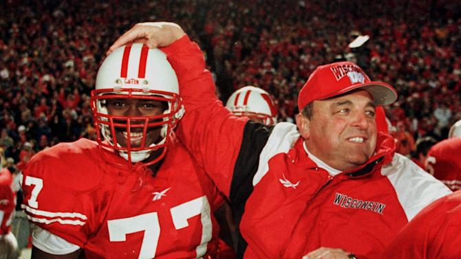 FILE - In this Nov. 21, 1998, file photo, Wisconsin's coach Barry Alvarez, right, congratulates Wendell Bryant on the sidelines near the end of the game of NCAA college football game against Penn State in Madison, Wis. Thirty years after he finished his playing career at Nebraska, Alvarez went to Wisconsin and built the Badgers' program in the image of the Cornhuskers. No one's more excited than Alvarez, now Wisconsin's athletic director, about Nebraska playing its inaugural Big Ten game on the Badgers' field on Saturday. (AP Photo/Andy Manis File)