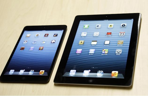 The iPad mini, at left, is shown next to the 4th generation iPad in San Jose, Calif., Tuesday, Oct.  23, 2012. The device has a screen that's about two-thirds the size of the full-size model, and Appl