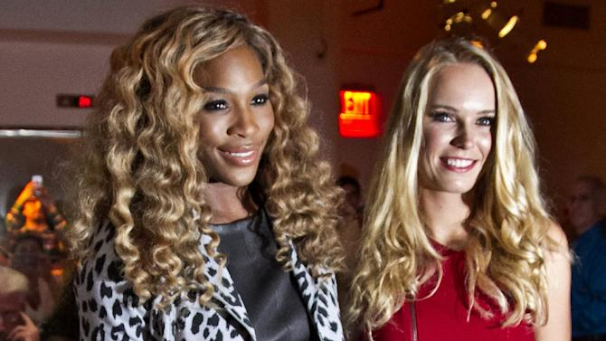 FILE - In this Sept. 9, 2014 file photo,  U.S. Open 2014 tennis champion Serena Williams, left, poses with U.S. Open runner-up Caroline Wozniacki before showing her Spring 2015 collection during Fashion Week in New York.   In their latest public display of friendship, Williams and Wozniacki posted a photo of getting their nails done before the Australian Open. The camaraderie, in a sport better known for its rivalries, has prompted discussion among players on what it's like in the locker room and behind-the-scenes with top tennis stars. (AP Photo/Bebeto Matthews, File)