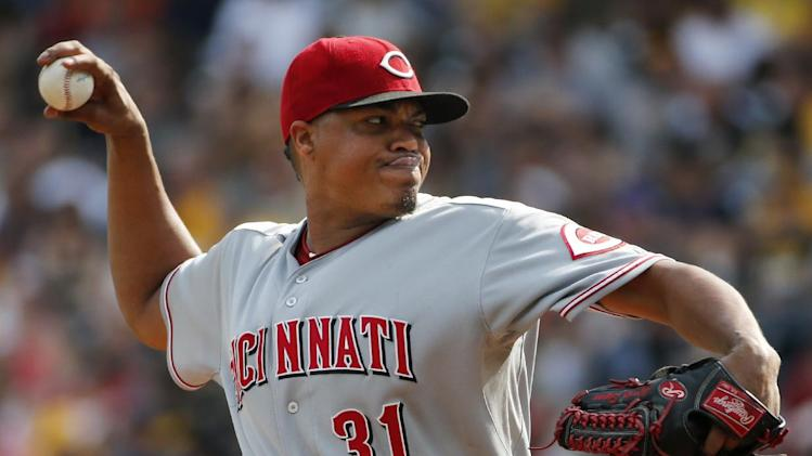 Cincinnati Reds starting pitcher Alfredo Simon (31) delivers during the first inning of a baseball game against the Pittsburgh Pirates in Pittsburgh Saturday, Aug. 30, 2014. (AP Photo/Gene J. Puskar)