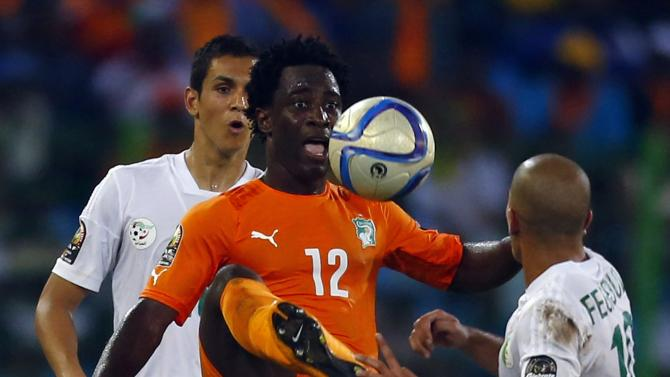 Ivory Coast's Wilfried Bony fights for the ball with Sofiane Feghouli of Algeria during their quarter-final soccer match of the 2015 African Cup of Nations in Malabo