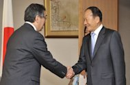 South Korean politician Lee Sang-Deuk (R), a former six-term ruling party lawmaker and elder brother of South Korean President Lee Myung-Bak, at the Foreign Ministry in Tokyo in May 2011. He was detained early Wednesday pending trial on corruption charges