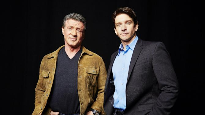 """In this Wednesday, Oct. 16, 2013 photo, Sylvester Stallone, left, who played Rocky Balboa in the 1976 film """"Rocky,"""" poses with Andy Karl, who will play Rocky Balboa in the upcoming Broadway musical """"Rocky,"""" in New York. (Photo by Dan Hallman/Invision/AP)"""