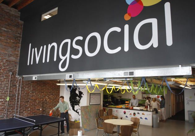 In this April 29, 2011 photo, Ross Arbes, 24, left, plays ping pong while on break at LivingSocial's offices in Washington. Online deals company LivingSocial announced Thursday, Nov. 29, 2012, it is cutting 400 jobs worldwide, or about 9 percent of its work force, as the deals market continues to face challenges. (AP Photo/Jacquelyn Martin, File)