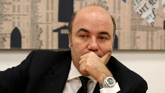 Monte dei Paschi di Siena bank CEO Fabrizio Viola listen's to a reporter's question during a press conference at the Foreign Press Association in Milan, Italy, Monday, Jan. 28, 2013. Viola says the embattled bank increased its request for government aid by 500 million euro (672 million dollars) after incoming managers found a document in a company safe in late October indicating trading losses. Viola says the document tied together two complex financial trades that had until then seemed unrelated. He says neither had been accounted for on the books. Montipaschi is investigating three complex loss-making financial transactions that have become fodder for the campaign for next month's national elections. (AP Photo/Antonio Calanni)