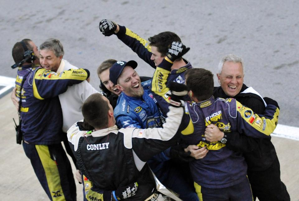 Members of David Ragan's pit crew celebrate after he won the NASCAR Sprint Cup Series Aaron's 499 auto race at Talladega Superspeedway in Talladega, Ala., Sunday, May 5, 2013. (AP Photo/Dan Lighton)