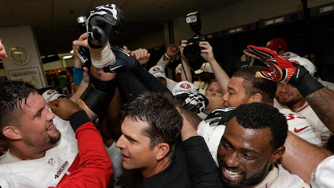 The San Francisco 49ers celebrate with head coach Jim Harbaugh, center, after the NFL football NFC Championship game against the Atlanta Falcons Sunday, Jan. 20, 2013, in Atlanta. The 49ers won 28-24 to advance to Super Bowl XLVII. (AP Photo/Dave Martin)