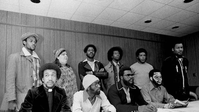 RETRANSMITTING TO CORRECT SPELLING OF NAME TO ANN SHEPARD FILE - This Jan. 21, 1976 file photo shows the Wilmington Ten at a news conference in Raleigh, North Carolina. From left, front row, they are Chavis, William (Joe) Wright, Connie Tindall and Jerry Jacobs. In the back row are Wayne Moore, Ann Shepard, James McKoy, Willie Vereen, Marvin Patrick and Reginald Epps. Outgoing North Carolina Gov. Beverly Perdue issued pardons Monday, Dec. 31, 2012 to the Wilmington 10, a group wrongly convicted 40 years ago in a notorious Civil Rights-era prosecution that led to accusations of the state holding political prisoners.  (AP Photo, file)