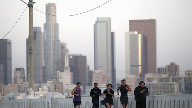 Los Angeles Superior Court Judge Craig Mitchell, 58, leads runners from the Midnight Mission Running Club on a sunrise run through Skid Row in Los Angeles